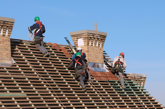 Men working on top of a roof.
