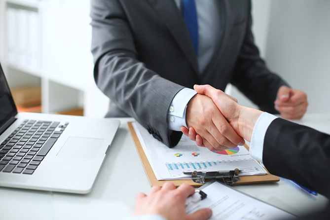 Solicitor shaking hands with a client.