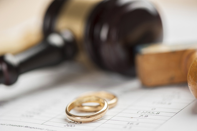 Two wedding rings placed on a judges desk after meeting with divorce solicitors.